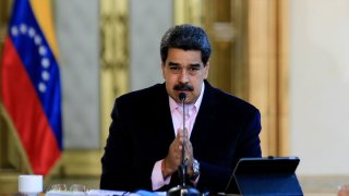 In this March 26, 2020, handout picture released by the Venezuelan Presidency, Venezuelan President Nicolas Maduro speaks during a televised announcement at Miraflores Presidential Palace in Caracas.