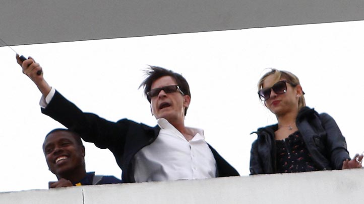 Charlie Sheen and Natalie Kenly at the Live Nation headquarters