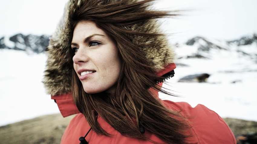 woman wind blowing winter coat