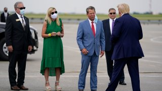 Georgia Gov. Brian Kemp, third from left, greets President Donald arrives at Hartsfield-Jackson International Airport, Wednesday, July 15, 2020, in Atlanta.