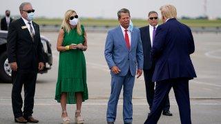 Georgia Gov. Brian Kemp, third from left, greets President Donald arrives at Hartsfield-Jackson International Airport, Wednesday, July 15, 2020, in Atlanta.