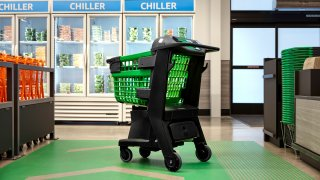 In a photo provided by Amazon, the company's smart shopping cart is seen in spring 2020 in Los Angeles. The cart, which Amazon unveiled Tuesday, uses cameras, sensors and a scale to automatically detect what shoppers drop in.