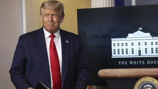 U.S. President Donald Trump arrives to a news conference in the James S. Brady Press Briefing Room at the White House in Washington, D.C., U.S. on Tuesday, July 28, 2020. Trump will allow certain young, undocumented immigrants to renew deportation protections for one year as his administration reviews a Supreme Court decision that blocked his efforts to end a program designed to let them to remain in the U.S.