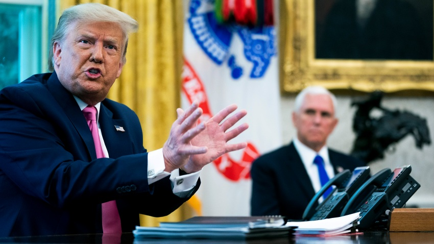 WASHINGTON, DC - JULY 20: U.S. President Donald Trump talks to reporters with Vice President Mike Pence in the Oval Office at the White House July 20, 2020 in Washington, DC. Trump hosted Republican Congressional leaders and members of his cabinet to talk about a proposed new round of financial stimulus to help the economy during the ongoing global coronavirus pandemic.