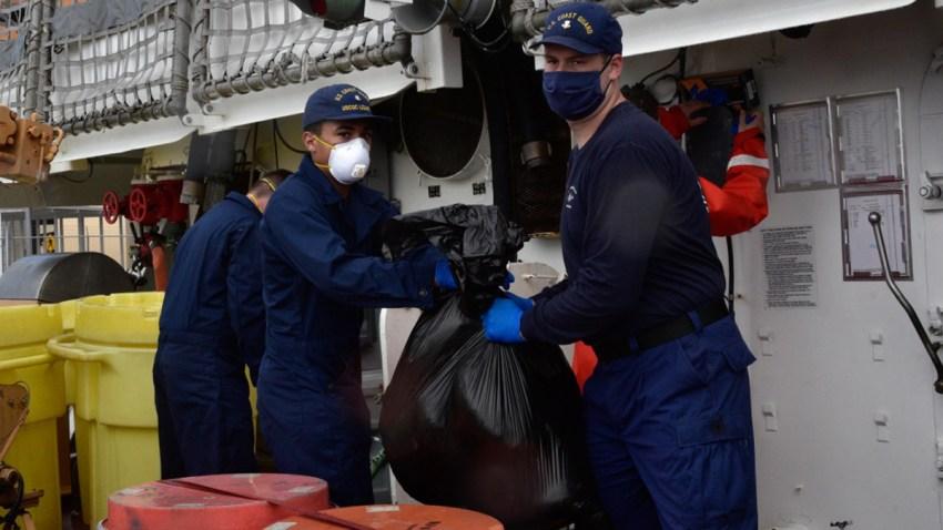 Coast Guard Cutter Legare crew members offload about 3,900 pounds of marijuana, Aug. 5, 2020, Port Everglades, Florida.