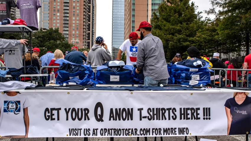 A vendor sells Qanon shirts ahead of a rally with U.S. President Donald Trump and Senator Ted Cruz, a Republican from Texas, in Houston, Texas, U.S., on Monday, Oct. 22, 2018.