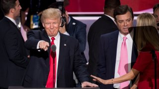 UNITED STATES - NOVEMBER 27: Donald Trump, flanked by campaign manager Paul Manafort and daughter Ivanka, checks the podium early Thursday afternoon in preparation for accepting the GOP nomination to be President at the 2016 Republican National Convention in Cleveland, Ohio on Wednesday July 20, 2016.