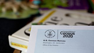 In this March 24, 2020, file photo, a U.S. Census 2020 invitation is arranged for a photograph in Arlington, Virginia.