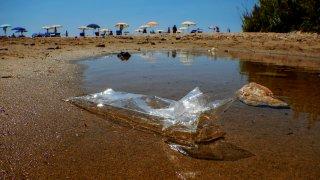 Plastic waste abandoned on the beach of the sea in Gaeta, Lazio region.