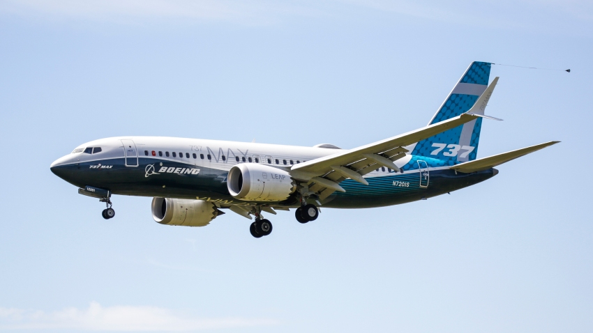 A Boeing 737 MAX jet comes in for a landing following a Federal Aviation Administration (FAA) test flight at Boeing Field in Seattle, Washington on June 29, 2020. - US regulators conducted the first a test flight of the Boeing 737 MAX on Monday, a key step in recertifying the jet that has been grounded for more than a year following two fatal crashes. A MAX aircraft took off from Boeing Field in Seattle at 1655 GMT, a Federal Aviation Administration spokesperson said. (