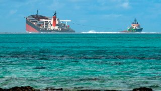 A picture taken on August 15, 2020 near Blue Bay Marine Park, shows the vessel MV Wakashio, belonging to a Japanese company but Panamanian-flagged, that ran aground near Blue Bay Marine Park off the coast of south-east Mauritius