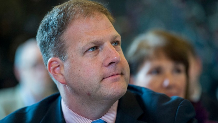 Chris Sununu listens during a State of New Hampshire Executive Council meeting at the Children's Museum of New Hampshire in Dover, N.H., Aug. 26, 2015.