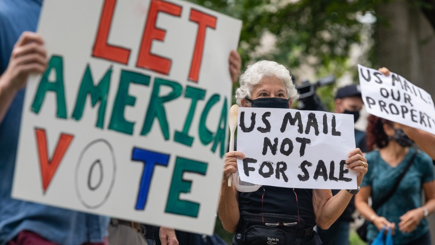 Demonstrators with Shut Down DC protest prepare to march to the home of Postmaster General Louis DeJoy in Washington, D.C., U.S., on Saturday, Aug. 15, 2020.