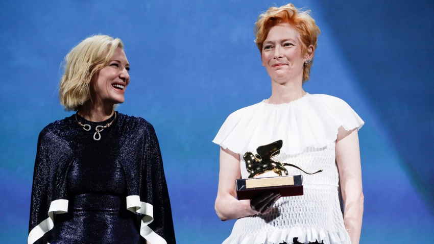 Actress Tilda Swinton, right, holds the Golden Lion for Lifetime Achievement, which was presented by Jury President Cate Blanchett