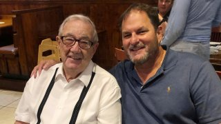 Dr. Carlos Vallejo, right, celebrates Dr. Jorge Vallejo's birthday on June 12, 2020, at a Cuban restaurant in Pembroke Pines, Florida. Both have died due to COVID-19.