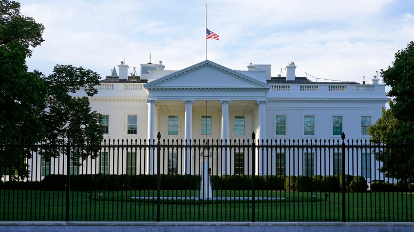 An American flag flies at half-staff over the White House in Washington
