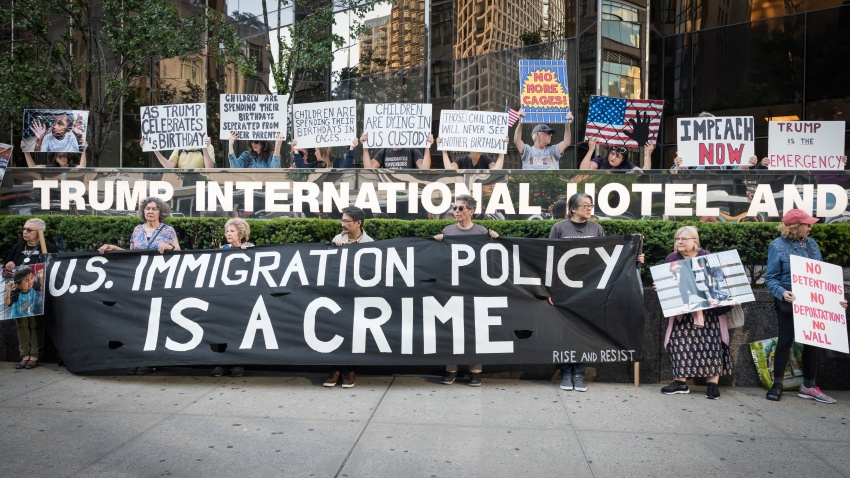 TRUMP INTERNATIONAL HOTEL AND TOWER, NEW YORK, UNITED STATES - 2019/06/14: Trump's Birthday, activists from Rise and Resist holding a banner as they protested the Trump's administrations' cruel and inhumane immigration policies in front of Trump International Tower and Hotel in Columbus Circle in Manhattan. An art installation depicting crying immigrant children in cages was also placed in front of the Tower and Hotel.