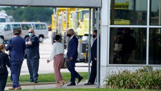 In this image taken from a motorcade, Democratic presidential candidate former Vice President Joe Biden exits a building after meeting with relatives of Jacob Blake at General Mitchell International Airport, Sept. 3, 2020, in Milwaukee.