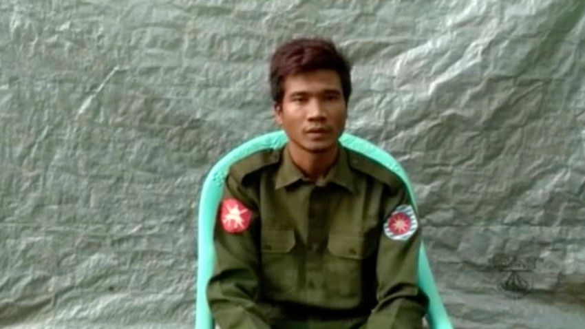 "In this image taken from video provided by the Arakan Army, Private Zaw Naing Tun provides a video testimony from an undisclosed location somewhere in Myanmar on July 8, 2020. Two soldiers who deserted from Myanmar's army have testified on video that they were instructed by commanding officers to ""shoot all that you see and that you hear"" in villages where minority Rohingya Muslims lived, a human rights group said Tuesday, Sept. 8, 2020."