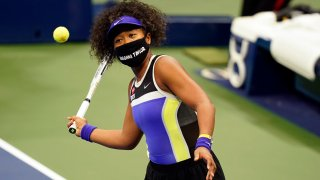 Naomi Osaka, of Japan, wears a mask in honor of Breonna Taylor as she celebrates after defeating Misaki Doi, of Japan, during the first round of the US Open tennis championships, Monday, Aug. 31, 2020, in New York.