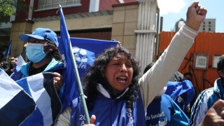 Supporters of presidential candidate Luis Arce shout slogans outside his headquarters one day after elections in La Paz, Bolivia