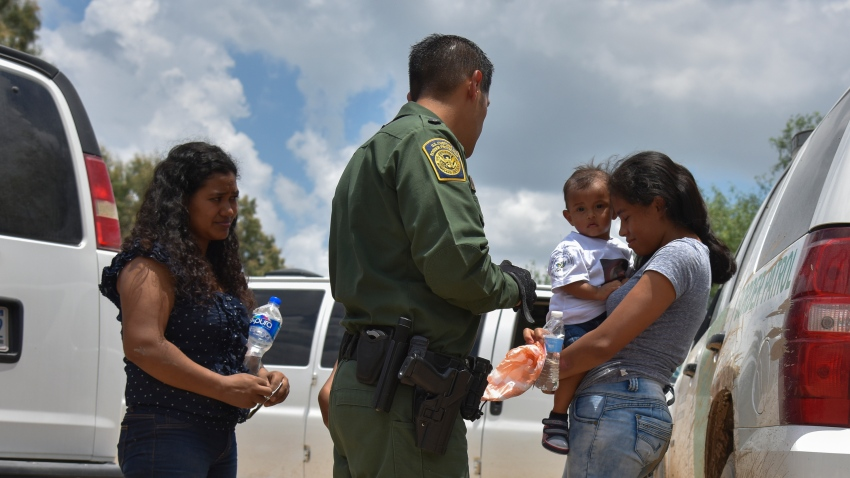 In this file photo, two young mothers from Honduras, L and R, and their respective children - a 12-year-old, blocked, and 1-year-old - are detained by United States Border Patrol after rafting across the Rio Grande on the U.S.-Mexico border on Monday, June 25, 2018, in Granjeno, TX.