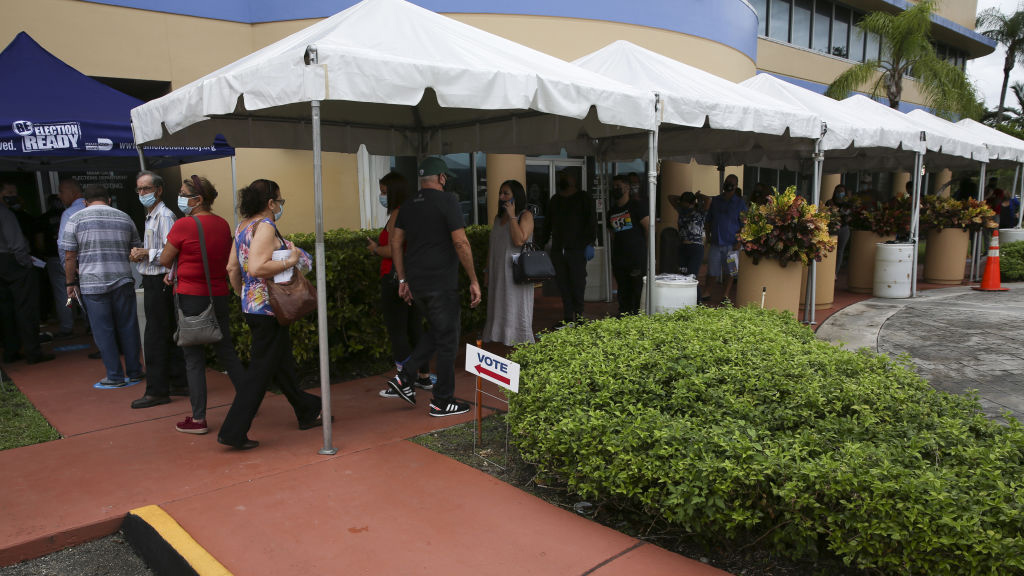 Rain or Shine, South Florida Voters Wait in Long Lines for First Day of Early Voting