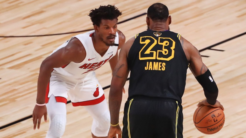 Jimmy Butler #22 of the Miami Heat defends LeBron James #23 of the Los Angeles Lakers