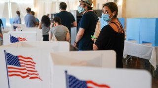 Voters at polls wearing masks.