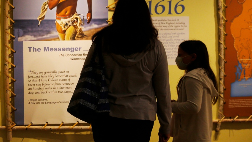 Visitors to the Pilgrim Monument and Provincetown Museum pause to examine a new exhibit in Provincetown, MA on Aug. 27, 2020. The new exhibit explores the early interactions between the Pilgrims and the Wampanoag tribe.