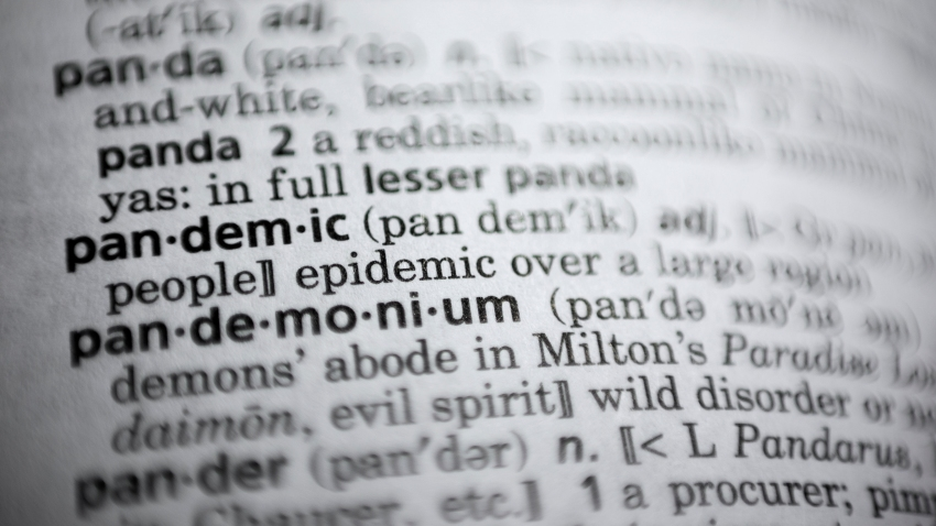 """In this Saturday, Nov. 21, 2020, photo the word pandemic is displayed in a dictionary in Washington. Merriam-Webster on Monday announced """"pandemic"""" as its 2020 word of the year."""