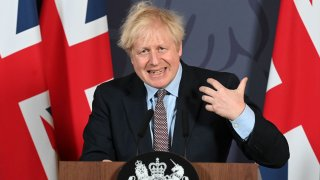 In this Dec. 24, 2020, file photo, Britain's Prime Minister Boris Johnson holds a remote press conference to update the nation on the post-Brexit trade agreement, inside 10 Downing Street in central London.