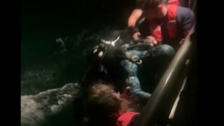 A diver who reported spending 10 hours drifting in water after being separated from his boat in the Florida Keys is rescued by the Coast Guard on Dec. 18, 2020.