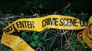 Crime Scene Tape Fallen On Grass