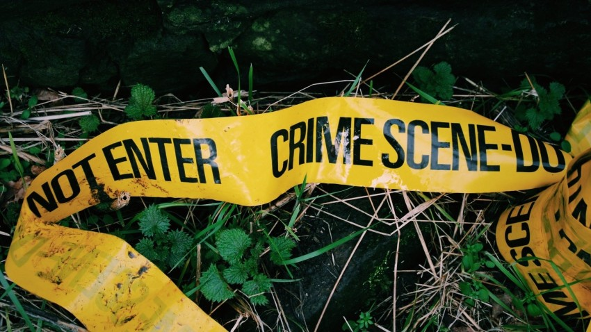 Crime Scene Tape Fallen On Grass