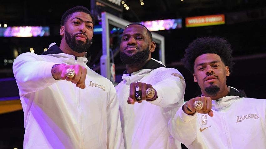 Anthony Davis #3, LeBron James #23 and Quinn Cook #2 of the Los Angeles Lakers pose for a photo as they get their 2019-20 NBA Championship ring during the ring ceremony before the game against the LA Clippers on December 22, 2020, at STAPLES Center in Los Angeles, California.