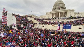 US President Donald Trumps supporters gather outside the Capitol building