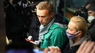 In this Jan. 17, 2021, file photo, Russian opposition leader Alexei Navalny and his wife Yulia are seen at the passport control point at Moscow's Sheremetyevo airport.