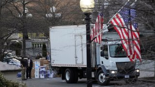 A moving van arrives to pick up boxes that were moved out of the Eisenhower Executive Office