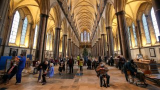 Members of the public receive the Pfizer-BioNTech coronavirus vaccine, at Salisbury Cathedral
