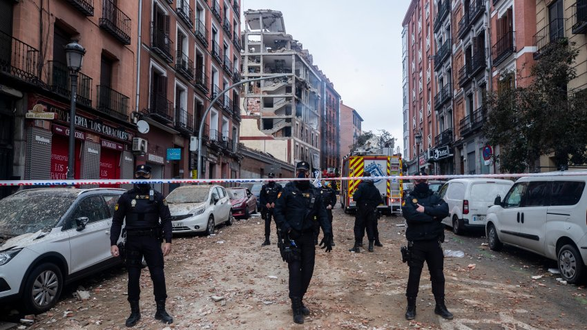 Police officers cordon off Toledo Street following an explosion in downtown Madrid