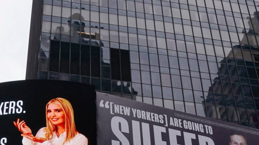 A billboard by The Lincoln Project is seen in Times Square on Oct. 25, 2020, in New York, depicting Ivanka Trump presenting the number of New Yorkers and Americans who have died due to Covid-19 along with her husband Senior Advisor to the President Jared Kushner, with a Vanity Fair quote.