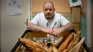 French baker Stephane Ravacley poses in his bakery in Besancon, eastern France, on January 6, 2021. - A baker of Besancon began a hunger strike on January 3, 2021, to keep his Guinean apprentice, a young adult subject to an obligation to leave the French territory (OQTF) and threatened with expulsion.
