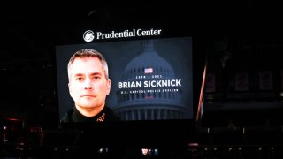 The New Jersey Devils honor slain Capitol police officer and New Jersey native Brian Sicknick before the game between the New Jersey Devils and the Boston Bruins during the home opening game at Prudential Center on January 14, 2021 in Newark, New Jersey