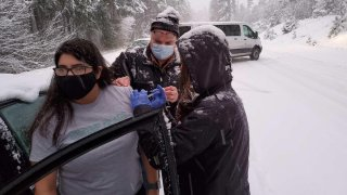 Oregon health workers who got stuck in a snowstorm on their way back from a COVID-19 vaccination event went car to car injecting stranded drivers before several of the doses expired