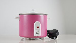 electrical rice cooker on white background