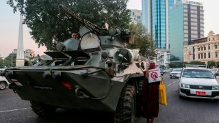In this Feb. 14, 2021, file photo, an armored vehicle drives past the Sule Pagoda, following days of mass protests against the military coup, in Yangon, Myanmar.