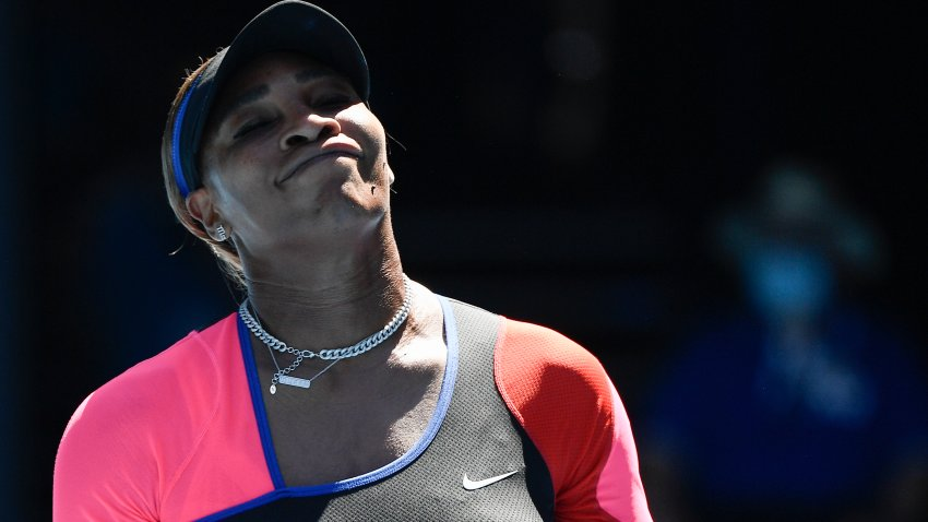 United States' Serena Williams reacts during her semifinal against Japan's Naomi Osaka at the Australian Open tennis championship in Melbourne, Australia, Thursday, Feb. 18, 2021.