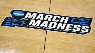A 'March Madness' logo on a basketball court