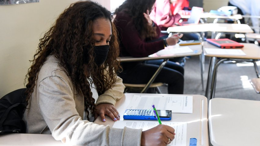 Giani Clarke,18, a senior at Wilson High School, takes a test in her AP Statistics class. The desks are doubled as a way to provide more social distancing.